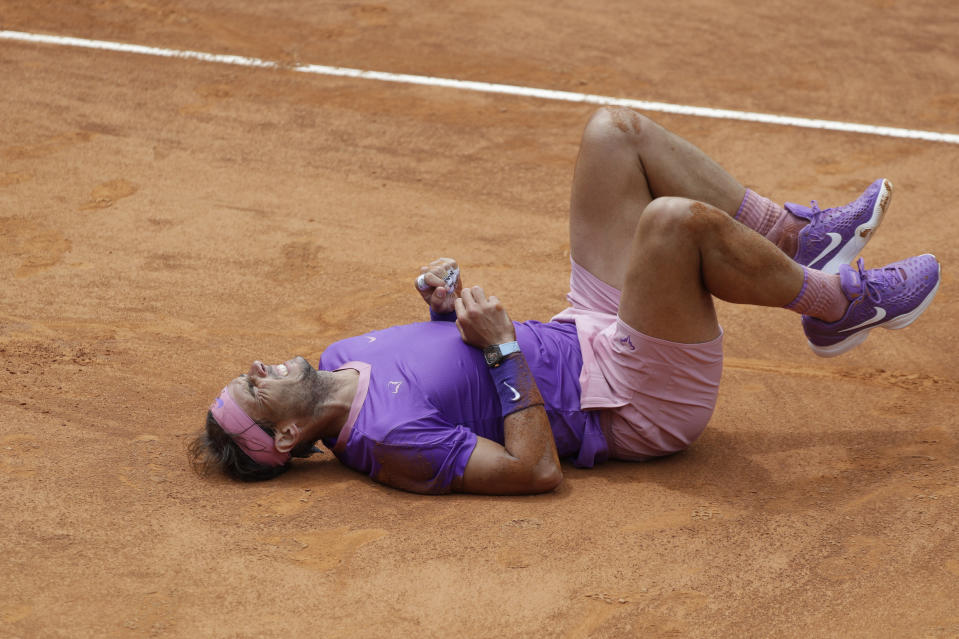 Spain's Rafael Nadal falls on the court as he attempts to return the ball to Germany's Alexander Zverev during their quarter-final match at the Italian Open tennis tournament, in Rome, Friday, May 14, 2021. (AP Photo/Gregorio Borgia)