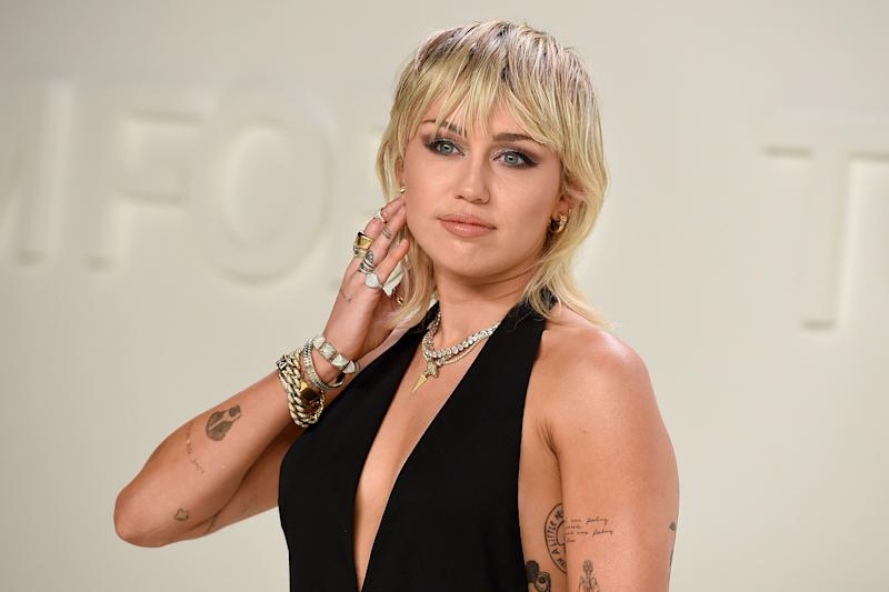 Miley at a Tom Ford fashion show earlier this year (Photo: Jordan Strauss/Invision/AP)