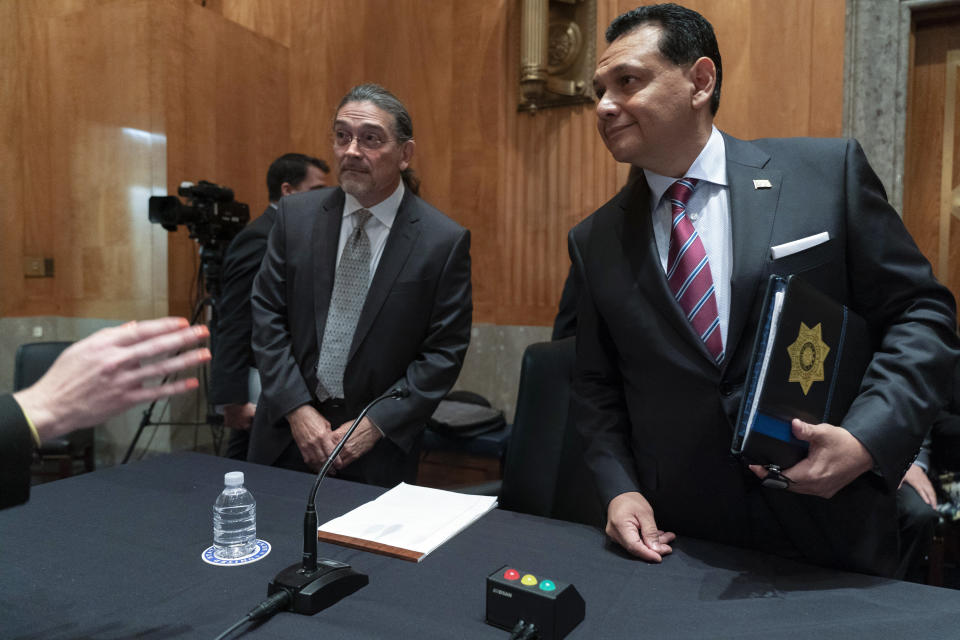Census Bureau Director nominee Robert Santos, left, and nominee for Assistant Secretary of Homeland Security, Ed Gonzalez, of Texas, listen to instructions as they arrive for a Senate Homeland Security and Governmental Affairs committee hearing on their nominations, Thursday, July 15, 2021, on Capitol Hill in Washington. If confirmed, Santos, a third-generation Mexican American, would be the first person of color to be a permanent head of the nation's largest statistical agency. (AP Photo/Jacquelyn Martin)