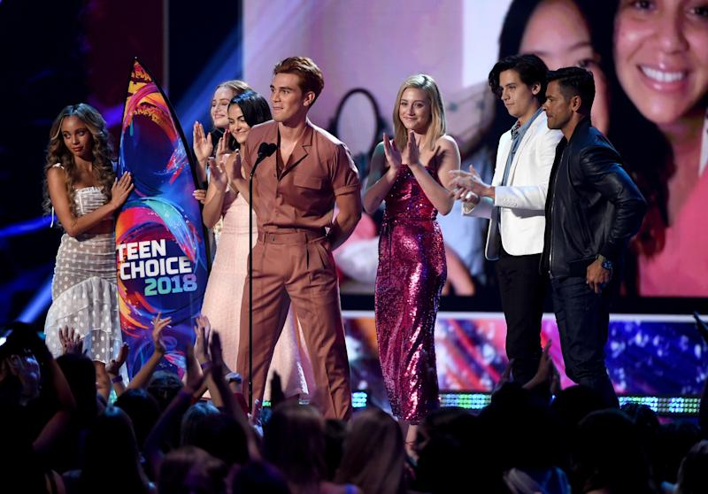 INGLEWOOD, CA - AUGUST 12: (L-R) Vanessa Morgan, Madelaine Petsch, Camila Mendes, KJ Apa, Lili Reinhart, Cole Sprouse and Mark Consuelos of 'Riverdale' accept the Choice Drama TV Show onstage during FOX's Teen Choice Awards at The Forum on August 12, 2018 in Inglewood, California. (Photo by Kevin Winter/Getty Images)
