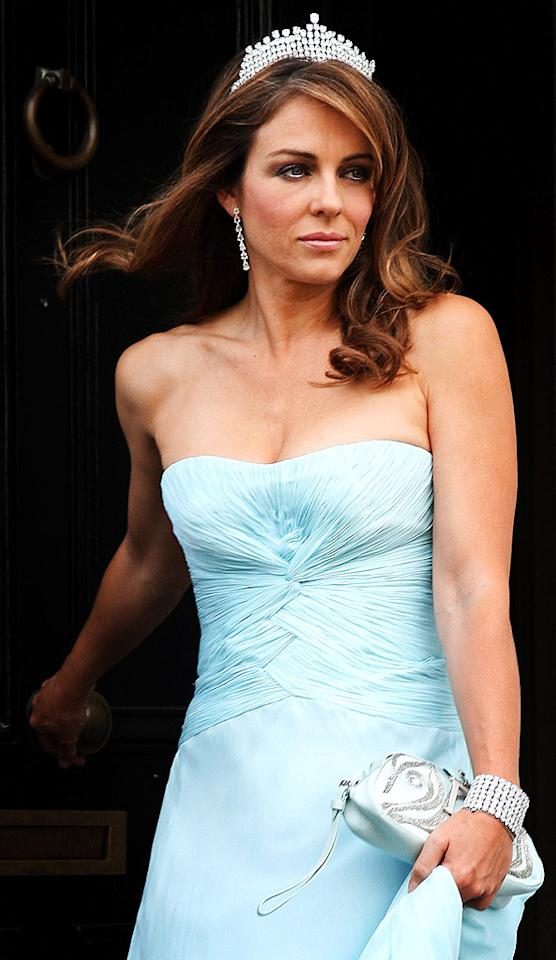 "Elizabeth Hurley made a dramatic exit from her London home in a sparkling headpiece, which was a requirement in order for her to gain entrance into Elton John's White Tie and Tiara Ball. Chris Jackson/<a href=""http://www.wireimage.com"" target=""new"">WireImage.com</a> - June 26, 2008"