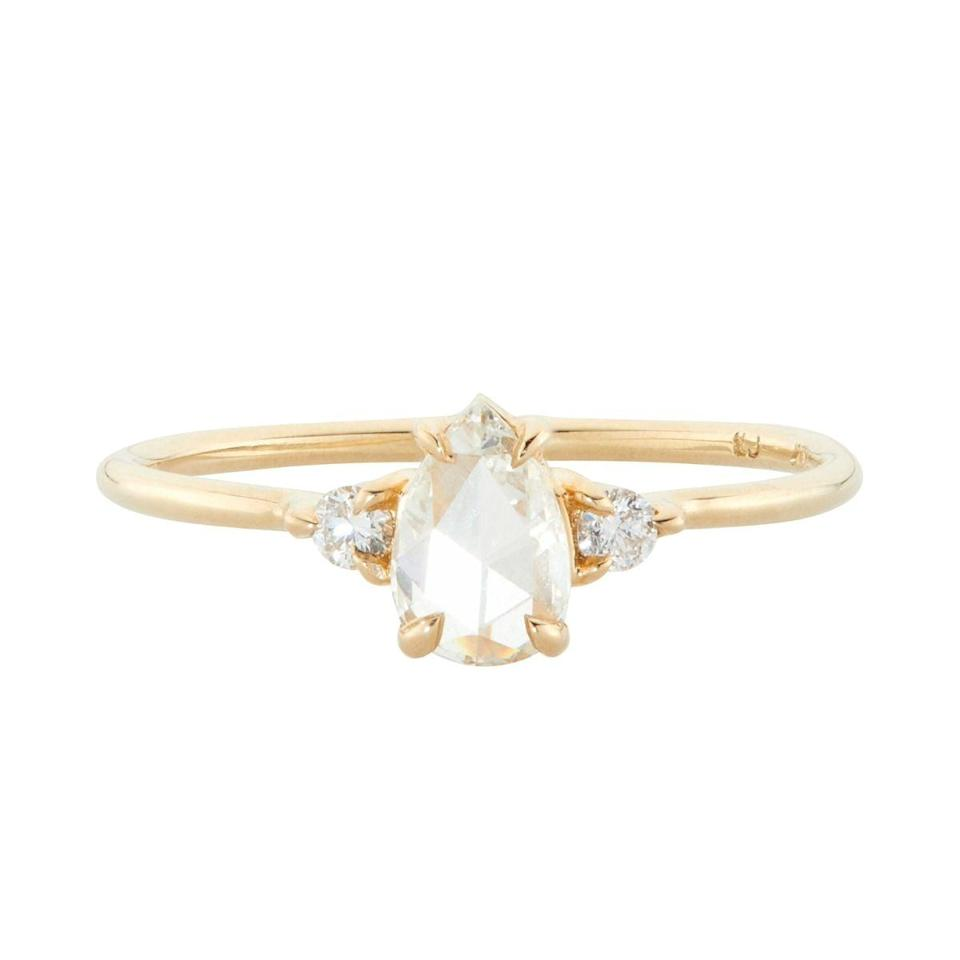 """<p>Tasteful and classy, this <a href=""""https://www.popsugar.com/buy/Leda-Swan-Ring-531770?p_name=Leda%20the%20Swan%20Ring&retailer=catbirdnyc.com&pid=531770&price=3%2C400&evar1=fab%3Aus&evar9=47015200&evar98=https%3A%2F%2Fwww.popsugar.com%2Ffashion%2Fphoto-gallery%2F47015200%2Fimage%2F47015975%2FThin-Bands-Leda-Swan-Ring&list1=shopping%2Cjewelry%2Crings%2Cengagement%20rings&prop13=mobile&pdata=1"""" rel=""""nofollow noopener"""" class=""""link rapid-noclick-resp"""" target=""""_blank"""" data-ylk=""""slk:Leda the Swan Ring"""">Leda the Swan Ring</a> ($3,400) features a gold band with three diamonds in the center.</p>"""