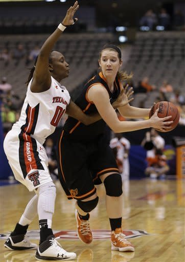 Oklahoma State forward Liz Donohoe, right, keeps the ball away from Texas Tech guard Chynna Brown (00) during the first half of an NCAA college basketball game in the Big 12 Conference tournament, Saturday March 9, 2013, in Dallas. (AP Photo/LM Otero)