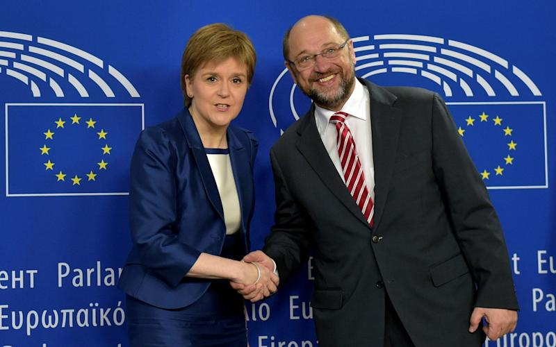 Scotland's First Minister Nicola Sturgeon is welcomed by European Parliament President Martin Schulz - Credit:  ERIC VIDAL