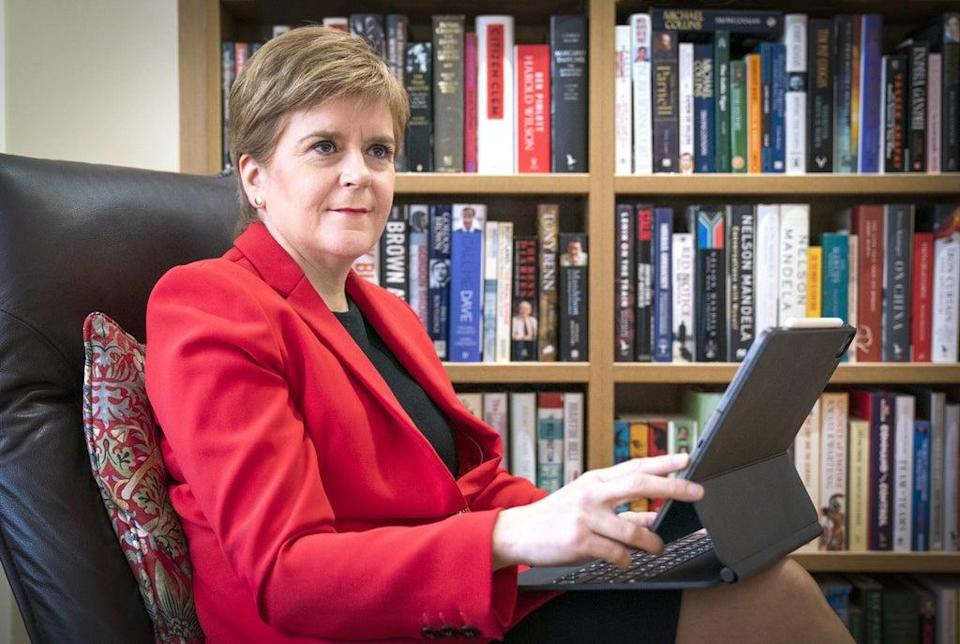 First Minister Nicola Sturgeon at her home in Glasgow preparing her speech she will give to the SNP National Conference virtually on Monday (Jane Barlow/PA) (PA Wire)
