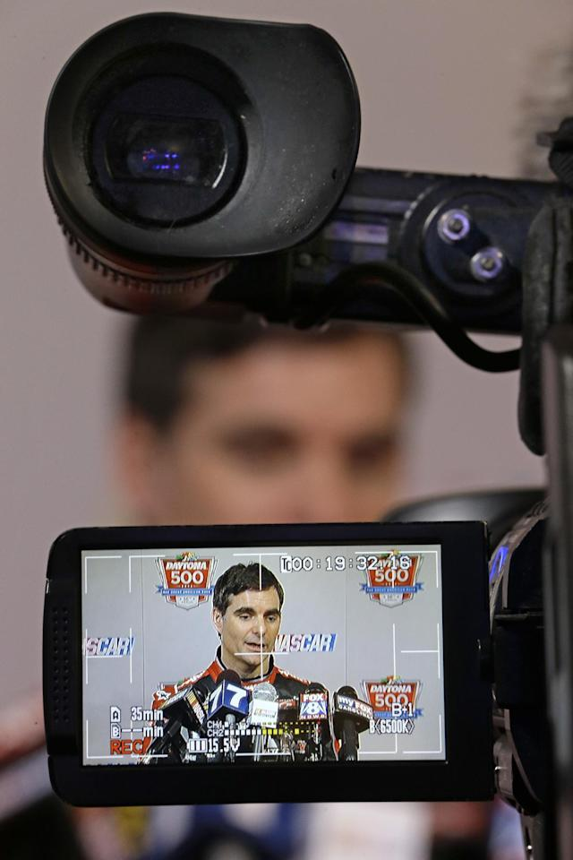 Driver Jeff Gordon image is displayed on a video camera screen as he answers questions during an interview at NASCAR auto racing media day at Daytona International Speedway in Daytona Beach, Fla., Thursday, Feb. 13, 2014. (AP Photo/John Raoux)