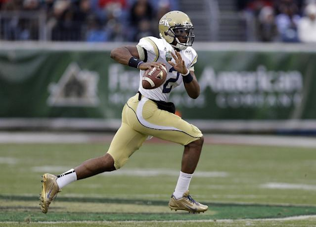 Georgia Tech quarterback Vad Lee scrambles against Mississippi in the second quarter of the NCAA college football Music City Bowl game on Monday, Dec. 30, 2013, in Nashville, Tenn. (AP Photo/Mark Humphrey)
