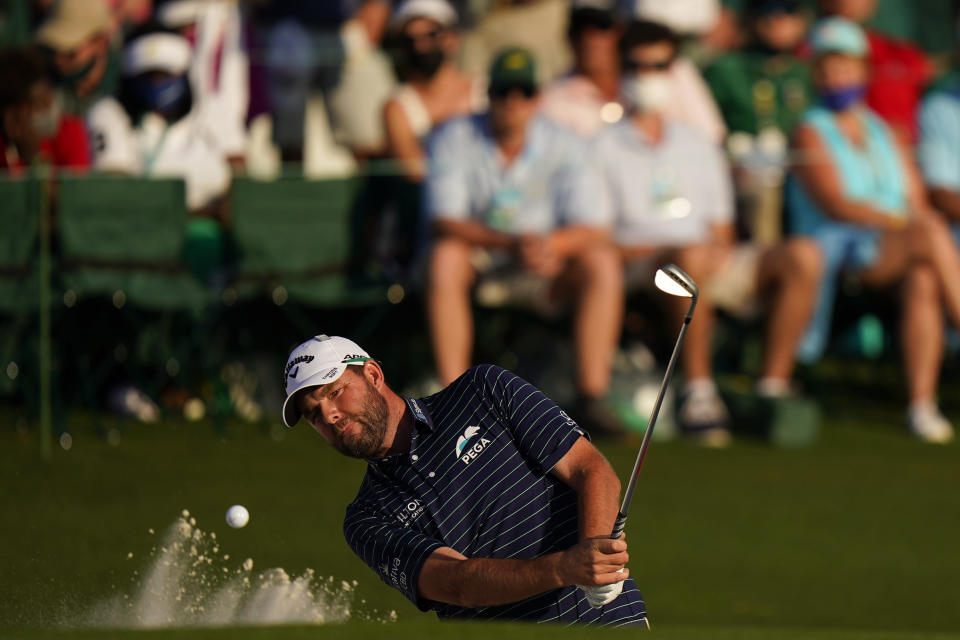 Marc Leishman, of Australia, hits from a bunker on the 18th hole during the final round of the Masters golf tournament on Sunday, April 11, 2021, in Augusta, Ga. (AP Photo/Matt Slocum)