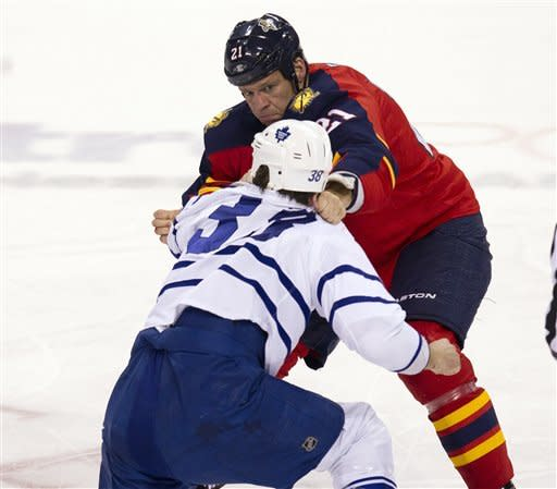 Toronto Maple Leafs' Jay Rosehill (38) and Florida Panthers' Krystofer Barch (21) exchange punches during the first period of an NHL hockey game in Sunrise, Fla., Tuesday, March 13, 2012. (AP Photo/J Pat Carter)