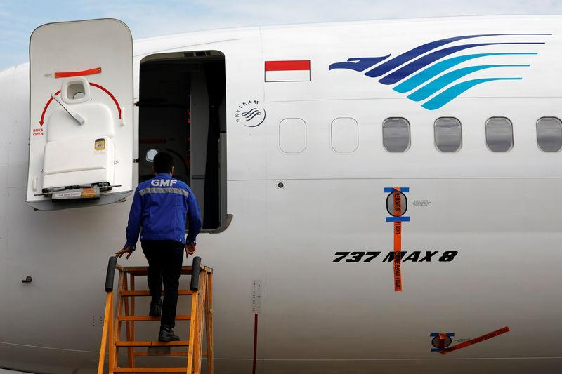 A technician prepares to check Garuda Indonesia's Boeing 737 Max 8 airplane parked at the Garuda Maintenance Facility AeroAsia, at Soekarno-Hatta International airport near Jakarta