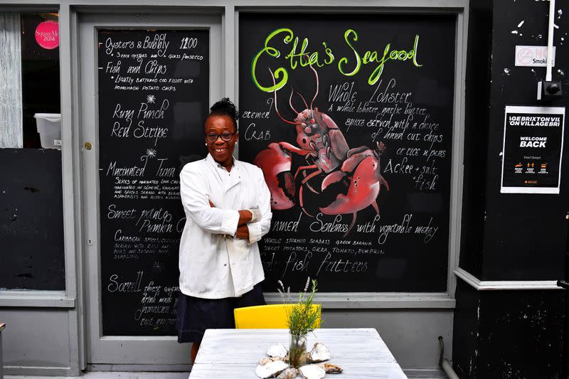 Etta Burrell, owner of Etta's Seafood Kitchen, stands outside her restaurant at Brixton Village in London
