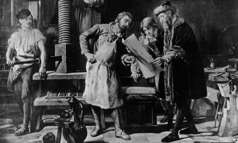 Johannes Gutenberg examines a page from his first printing press in 1450.