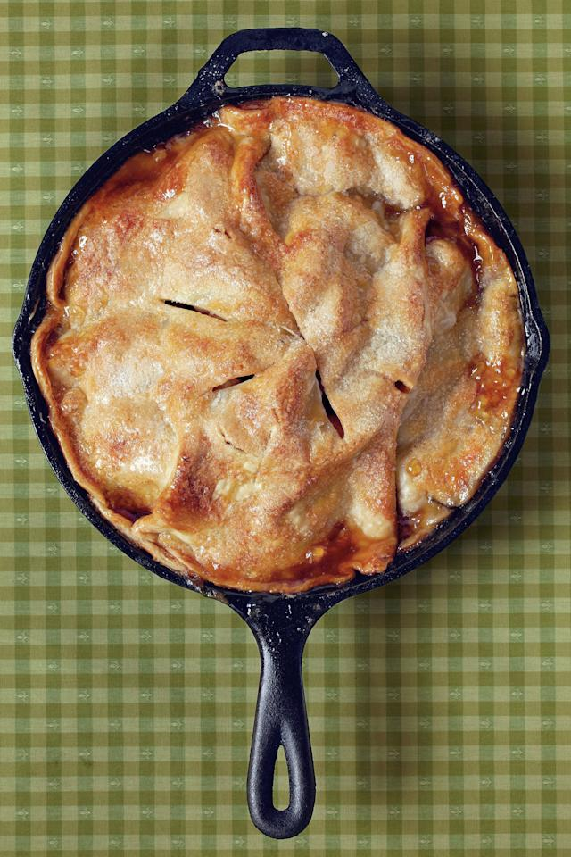 """<p><strong>Recipe:</strong> <a href=""""https://www.southernliving.com/recipes/easy-skillet-apple-pie"""" target=""""_blank""""><strong>Easy Skillet Apple Pie</strong></a></p> <p>Making an apple pie has never been so easy. Simply toss apples, cinnamon, and brown sugar, and spoon over a refrigerated pie crust in the cast-iron skillet. Top with the other crust and bake.</p> <p><strong>Watch: <a href=""""http://www.southernliving.com/food/how-to/easy-skillet-apple-pie-recipe-video"""" target=""""_blank"""">Easy Skillet Apple Pie</a></strong></p>"""