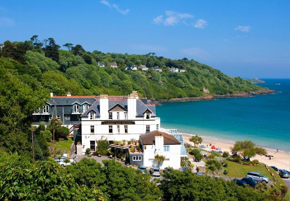 """<p>Caribbean or Cornwall? This incredible beach hotel in the UK offers a true slice of paradise right on our doorstep - no planes required. The flour-fine sand could rival any in the Mediterranean and is a privately-owned 25 acre Blue Flag beach.</p><p>Accommodation comes in the form of seriously stylish suites, beach houses and coastal cottages, making this sandy spot perfect for discerning families or couples in love.</p><p>After you've had your fill of Cornish crab and afternoon tea, head for some relaxation at the C Bay Spa, with its outdoor pool and breathtaking views. Sigh.</p><p><a class=""""link rapid-noclick-resp"""" href=""""https://go.redirectingat.com?id=127X1599956&url=https%3A%2F%2Fwww.booking.com%2Fhotel%2Fgb%2Fcarbis-bay-hotel.en-gb.html%3Faid%3D1922306%26label%3Dbeach-hotels-uk&sref=https%3A%2F%2Fwww.goodhousekeeping.com%2Fuk%2Flifestyle%2Ftravel%2Fg34584524%2Fbeach-hotels-uk%2F"""" rel=""""nofollow noopener"""" target=""""_blank"""" data-ylk=""""slk:CHECK AVAILABILITY"""">CHECK AVAILABILITY</a></p>"""