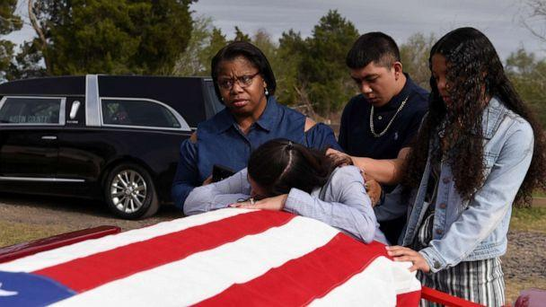 PHOTO: Lila Blanks is comforted by the casket of her husband, Gregory Blanks, 50, who died from complications from the coronavirus disease, in San Felipe, Texas, Jan. 26, 2021. (Callaghan O'hare/Reuters)