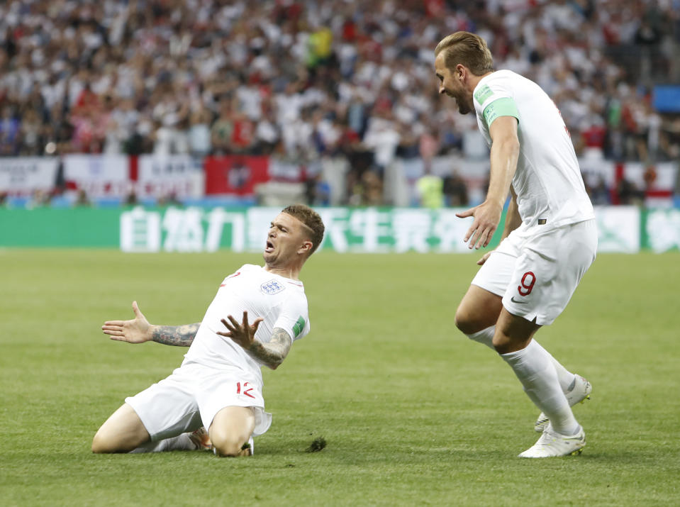England's Kieran Trippier, left, celebrates with Harry Kaneafter scoring the opening goal during the semifinal match between Croatia and England at the 2018 soccer World Cup in the Luzhniki Stadium in Moscow, Russia, Wednesday, July 11, 2018.(AP Photo/Alastair Grant)