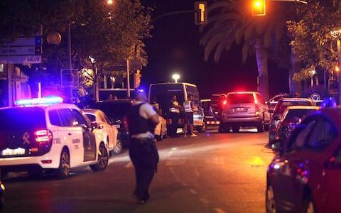 Spanish policemen patrol the street after five suspected terrorists were killed by the police in Cambrils - Credit: EPA