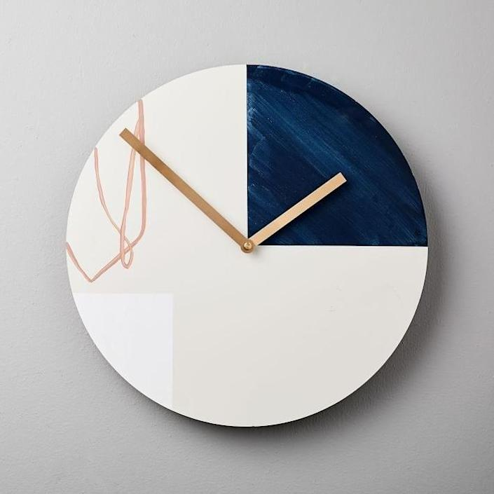 """This hand-painted, American-made wooden wall clock gives off an abstract vibe and measures 14 inches in diameter. $100, Etsy. <a href=""""https://www.westelm.com/products/scribble-clock-d5940/"""" rel=""""nofollow noopener"""" target=""""_blank"""" data-ylk=""""slk:Get it now!"""" class=""""link rapid-noclick-resp"""">Get it now!</a>"""