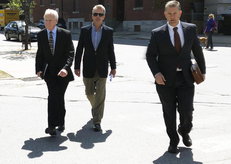 William Stenger, left, former president of Jay Peak resort, approaches federal court on Wednesday, May 22, 2019, in Burlington, Vt., to face fraud charges over a failed plan to build a biotechnology plant using foreign investors' money. He pleaded not guilty. (AP Photo/Lisa Rathke)