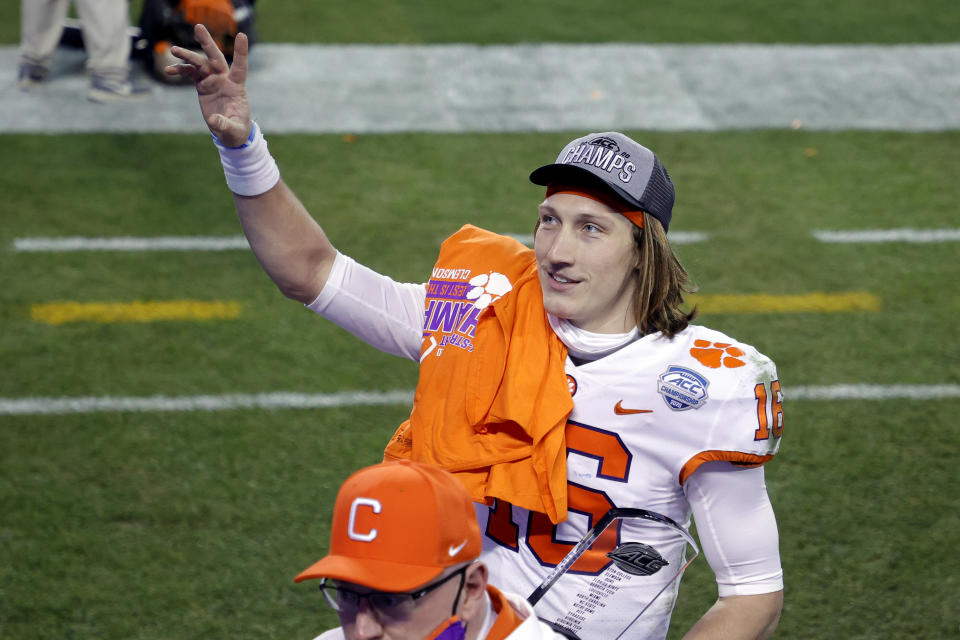 Trevor Lawrence acknowledges fans as he walks off the field after defeating the Notre Dame Fighting Irish 34-10 in the ACC Championship. (Jared C. Tilton/Getty Images)