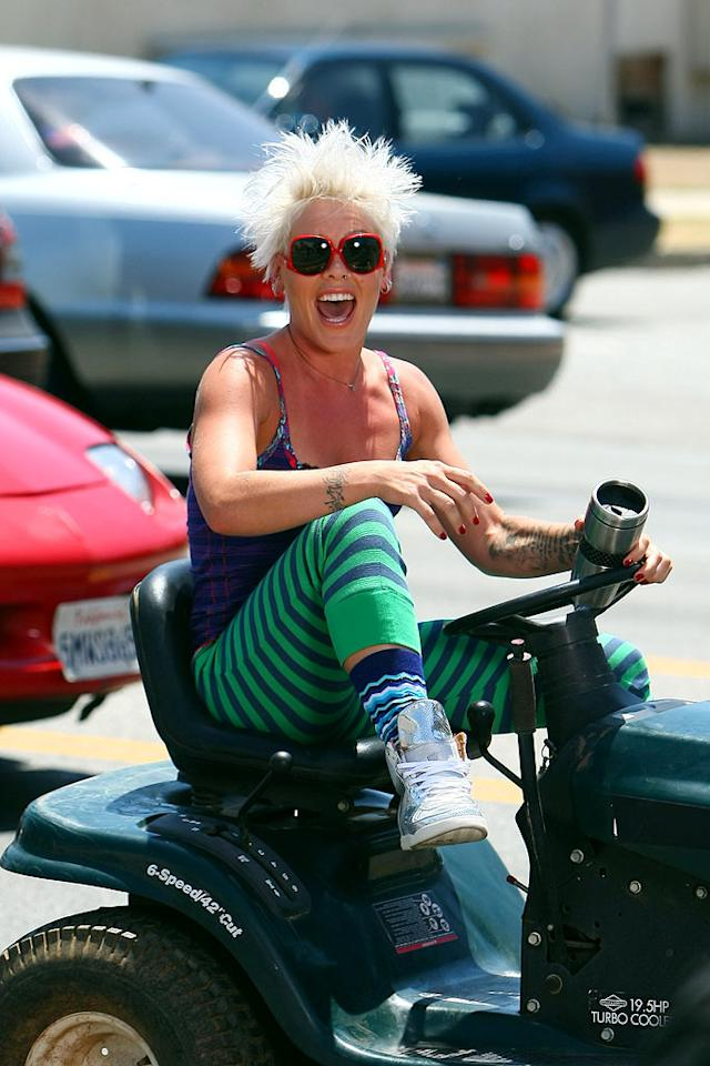 "Pink is back with a vengeance in an unsightly ensemble and crazy coif as she shoots the music video for her new single ""So What"" while riding a lawn mower down Sunset Boulevard! Ben Tsui/ Splash News - August 6, 2008"