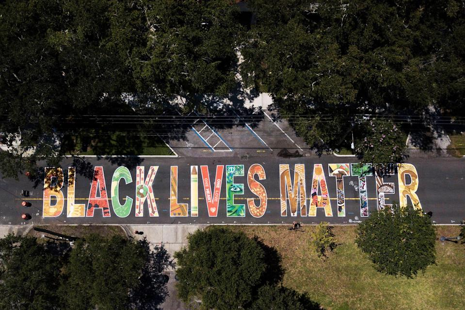 This Black Lives Matter street mural was painted by sixteen local artists in front of the Dr. Carter G. Woodson African-American museum in St. Petersburg, Florida. Each of the artists painted their own letter.