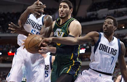 Enes Kanter (center) is looking for a trade from the Jazz. (USA Today)