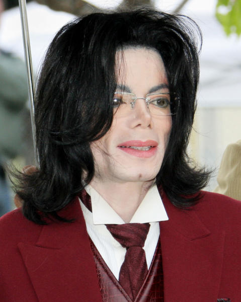 "FILE - In this April 27, 2005 file photo, Michael Jackson arrives at the Santa Barbara County courthouse in Santa Maria, Calif. Jackson's longtime makeup artist Karen Faye testified before a Los Angeles jury on May 9 – 10, 2013, while breaking down in tears as she described how Jackson trusted his doctors, but became more dependent on prescription medications in the early 1990s when he was on his ""Dangerous"" tour and facing his first bout of child molestation allegations. (AP Photo/Michael Mariant, Pool, File)"