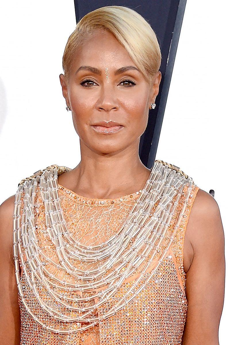 <p>A deep parted pixie to one side adds some dimension to the cut. We love Jada Pinkett Smith's glossy finish and golden hair color.</p>