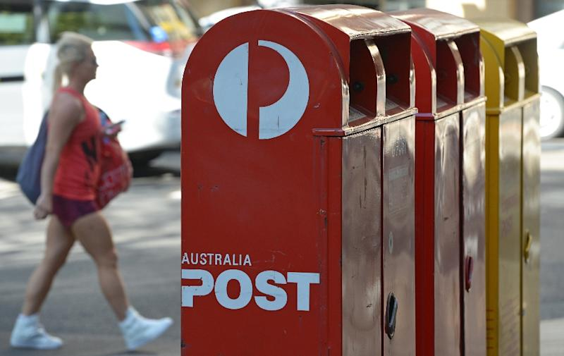 Australia Post is set to record its first full-year loss in more than three decades (AFP Photo/Greg Wood)