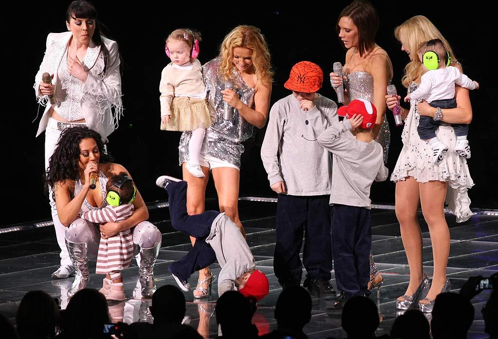 """The Spice Kids make an appearance alongside their moms. Three-year-old Cruz Beckham plays up to the crowd by showing off his breakdancing moves. <a href=""""http://www.splashnewsonline.com"""" target=""""new"""">Splash News</a> - February 18, 2008"""