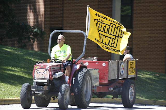 "Workers at St. Vincent College fly a ""Terrible Towel"" on their tractor as the Pittsburgh Steelers come to campus for NFL football training camp at the team training facility in Latrobe, Pa. on Friday, July 25, 2014. (AP Photo)"