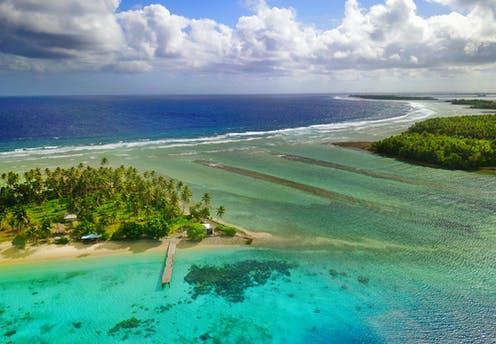 """<span class=""""attribution""""><a class=""""link rapid-noclick-resp"""" href=""""https://www.shutterstock.com/image-photo/beautiful-aerial-view-tropical-atoll-marshall-1393520135"""" rel=""""nofollow noopener"""" target=""""_blank"""" data-ylk=""""slk:big sea/Shutterstock"""">big sea/Shutterstock</a></span>"""