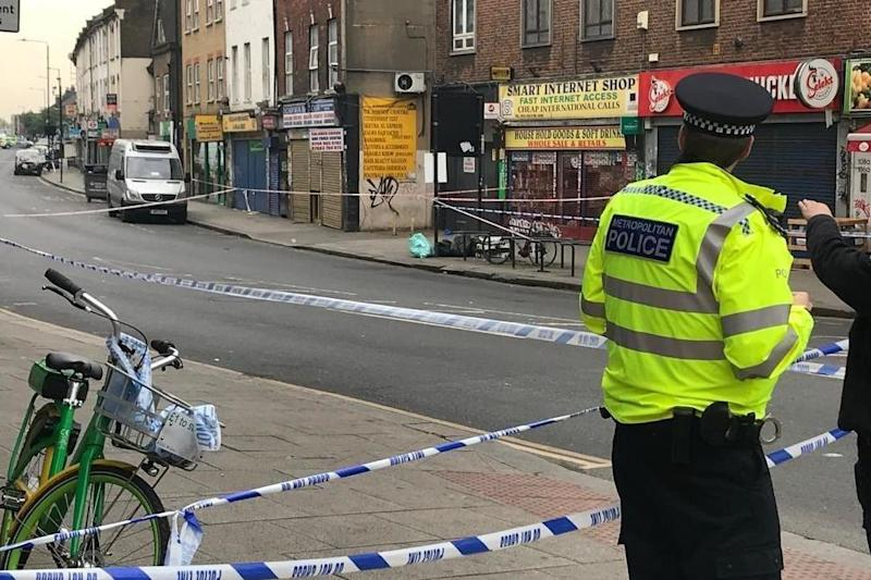 A police cordon on Harlesden High Street where a man was stabbed to death on Tuesday night