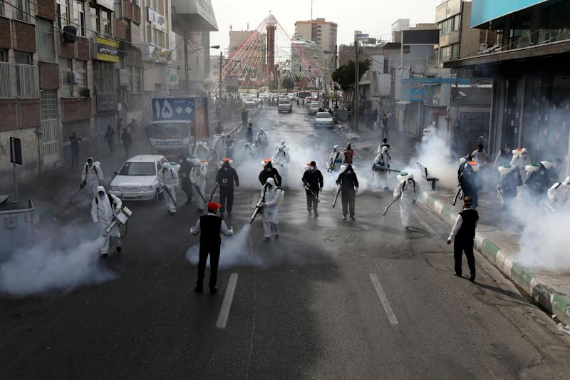 Firefighters disinfect a street against the new coronavirus, in western Tehran, Iran. (Photo: ASSOCIATED PRESS)