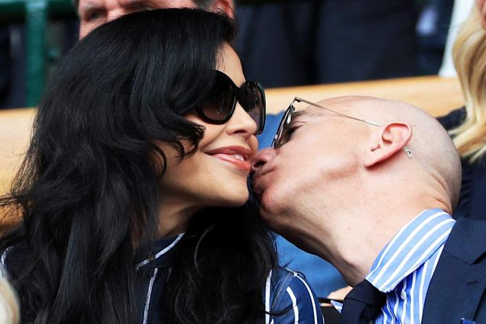 """<div class=""""inline-image__title"""">1155581071</div> <div class=""""inline-image__caption""""><p>""""LONDON, ENGLAND - JULY 14: Jeff Bezos and his partner, Lauren Sanchez, look on from the Royal Box on Centre Court on Day 13 of The Championships - Wimbledon 2019 at the All England Lawn Tennis and Croquet Club on July 14, 2019 in London, England. (Photo by Simon Stacpoole/Offside/Getty Images)""""</p></div> <div class=""""inline-image__credit"""">Simon Stacpoole/Offside/Getty</div>"""