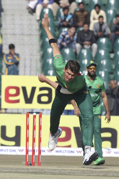 Pakistani bowler Shaheen Afridi bowls against Bangladesh at the Gaddafi Stadium in Lahore, Pakistan, Friday, Jan. 24, 2020. Pakistan and Bangladesh are playing their first T20 of the three matches series under tight security. (AP Photo/K.M. Chaudary)