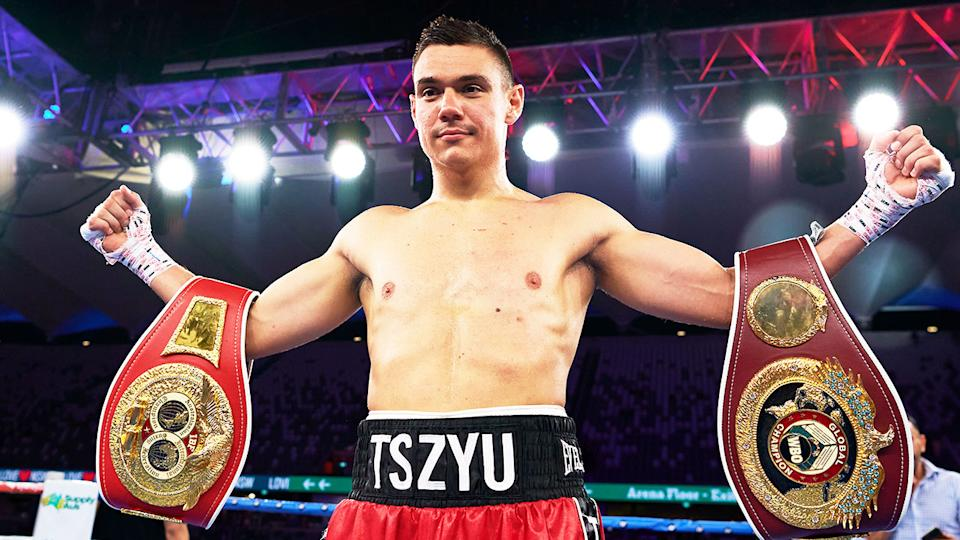 Tim Tszyu (pictured) poses for a photo with his belts after a fight.