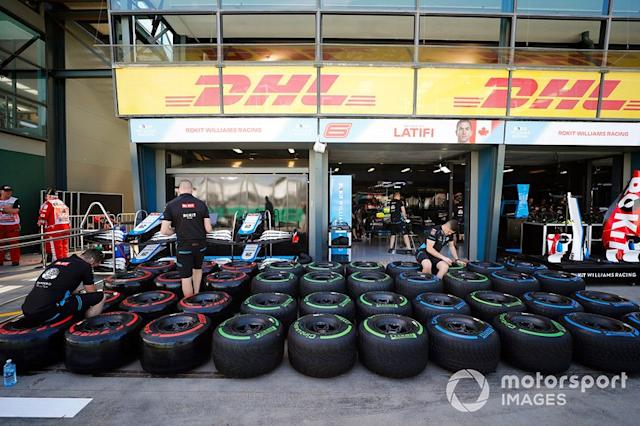 """The Williams team prepare tyres in the pits <span class=""""copyright"""">Glenn Dunbar / Motorsport Images</span>"""