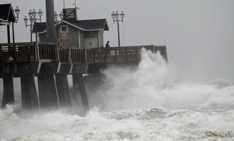 Large waves generated by Hurricane Sandy crash into Jeanette's Pier in Nags Head, N.C., Saturday, Oct. 27, 2012 as the storm moves up the east coast. Hurricane Sandy, upgraded again Saturday just hours after forecasters said it had weakened to a tropical storm, was barreling north from the Caribbean and was expected to make landfall early Tuesday near the Delaware coast, then hit two winter weather systems as it moves inland, creating a hybrid monster storm. (AP Photo/Gerry Broome)
