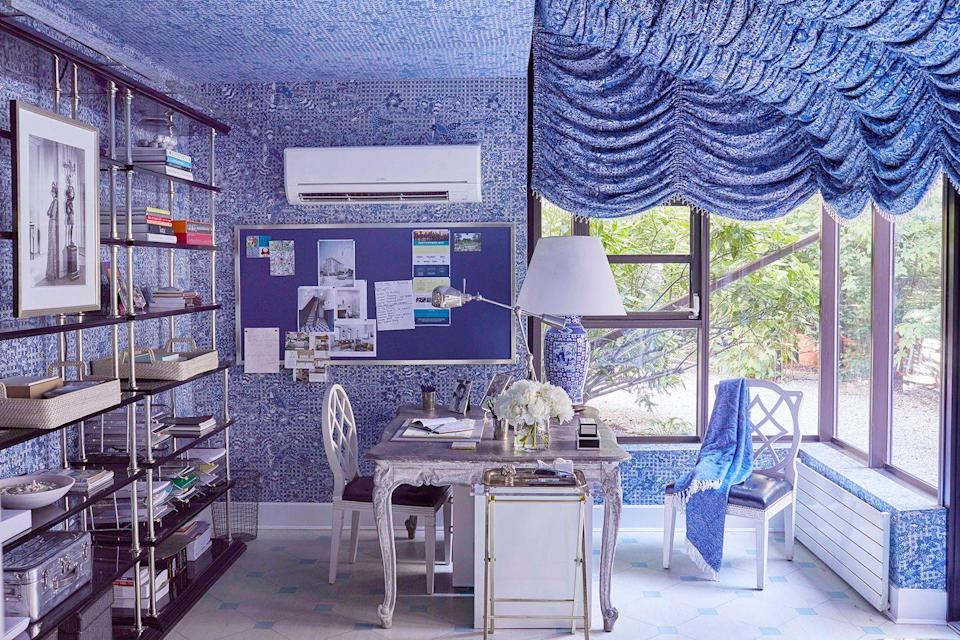 <p>In this fabulously over-the-top home office designed by Miles Redd, the tented ceiling provides some privacy and warmth while the corresponding wallpaper helps ease the transition between the windows and the walls for a stylish flow. He added a matching blue pin-board on the wall to keep papers from piling up on the desk. </p>