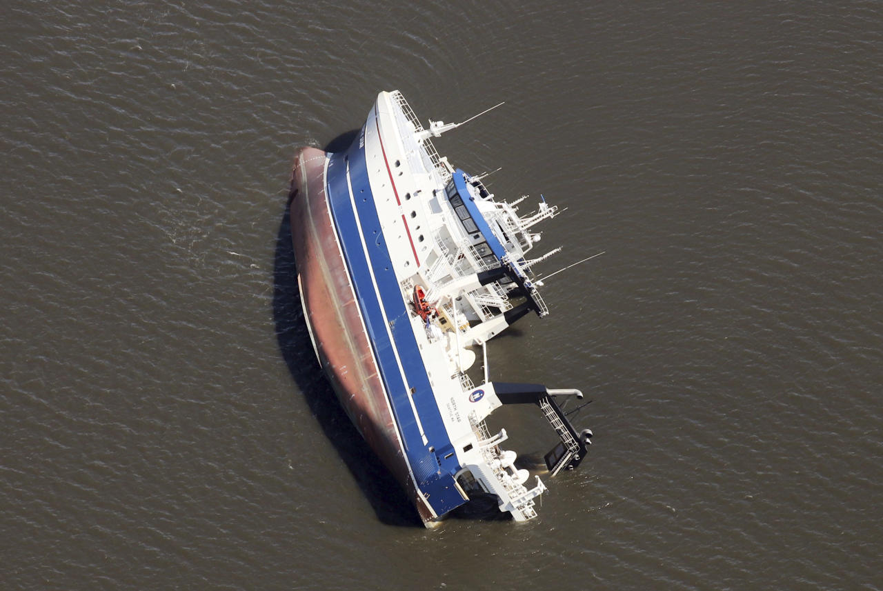 <p>A large ship lists on its side in the St. Andrew Bay, at Panama City, Fla., in this aerial shot Thursday, October 11, 2018, a day after Hurricane Michael struck with near Category 5 winds. (Photo: Michael Snyder/Northwest Florida Daily News/AP) </p>