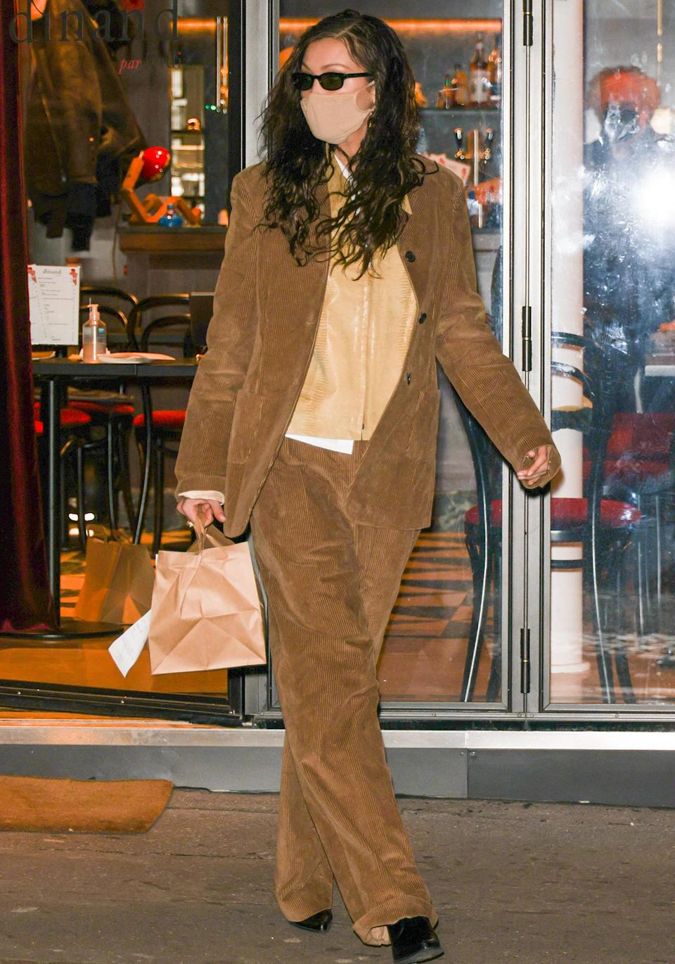 <p>Bella Hadid steps out in a brown blazer and matching trousers to pick up food from a restaurant in Paris on Tuesday.</p>