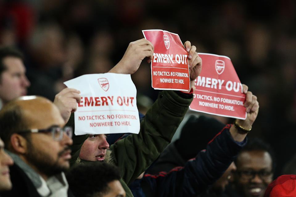"LONDON, ENGLAND - NOVEMBER 28: Arsenal fans hold up signs saying ""Emery out"" during the UEFA Europa League group F match between Arsenal FC and Eintracht Frankfurt at Emirates Stadium on November 28, 2019 in London, United Kingdom. (Photo by Craig Mercer/MB Media/Getty Images)"