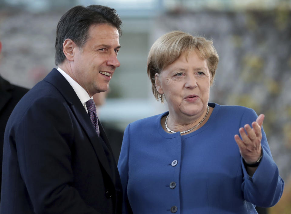 FILE - In this Tuesday, Nov. 19, 2019 file photo, German Chancellor Angela Merkel, right, and Italy's Prime Minister Giuseppe Conte, left, shake hands prior to a meeting at the chancellery as part of the 'Compact with Africa' conference in Berlin, Germany. When Giuseppe Conte exited the premier's office, palace employees warmly applauded in him appreciation. But that's hardly likely to be Conte's last hurrah in politics. Just a few hours after the handover-ceremony to transfer power to Mario Draghi, the former European Central Bank chief now tasked with leading Italy in the pandemic, Conte dashed off a thank-you note to citizens that sounded more like an ''arrivederci″ (see you again) then a retreat from the political world he was unexpectedly propelled into in 2018.(AP Photo/Michael Sohn, File)