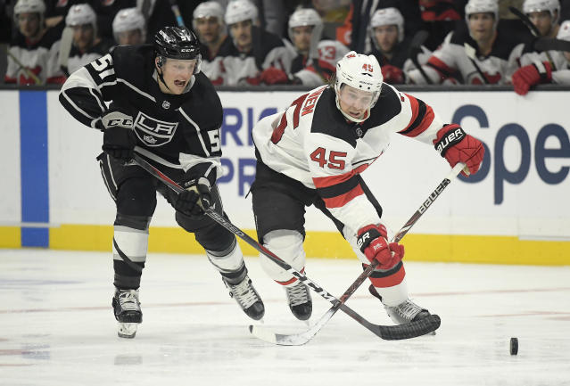 Los Angeles Kings left wing Austin Wagner, left, and New Jersey Devils defenseman Sami Vatanen, of Finland, race for the puck during the second period of an NHL hockey game Thursday, Dec. 6, 2018, in Los Angeles. (AP Photo/Mark J. Terrill)