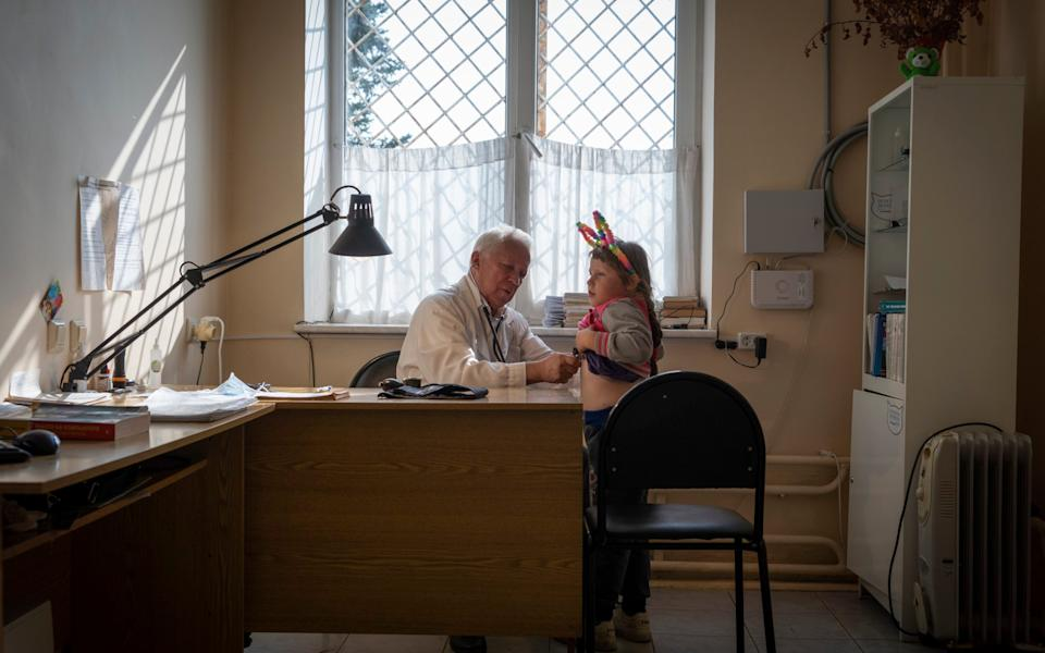 Doctor Yuri Sokolov with a young patient - Andrey Borodulin