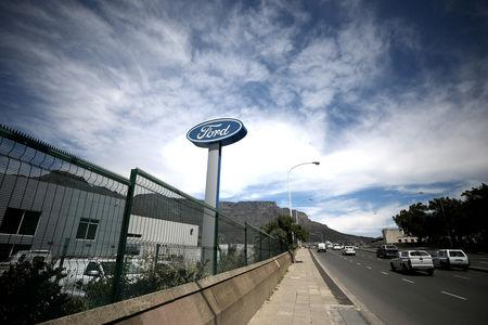 The logo of the Ford Motor Company is seen outside a car dealership in Cape Town