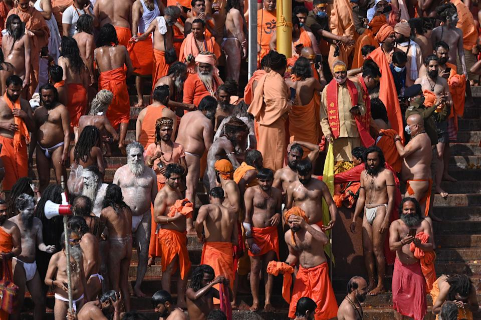 Naga Sadhus (Hindu holy men) gather to take a holy dip in the waters of the River Ganges on the Shahi snan (grand bath) on the occasion of Maha Shivratri festival during the ongoing religious Kumbh Mela festival in Haridwar on March 11, 2021. (Photo by Prakash SINGH / AFP) (Photo by PRAKASH SINGH/AFP via Getty Images)
