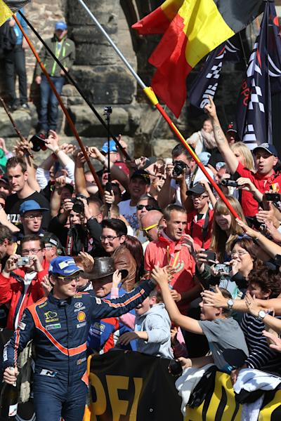 Belgium's Thierry Neuville celebrates with fans on August 24, 2014 in Trier, central Germany after winning the ADAC Rally of Germany as part of WRC World Rallye Championship (AFP Photo/Thomas Frey)